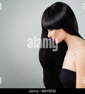 Long Hair Woman. Beautiful Model Girl with Healthy Hair on Gray Background - Stock Photo