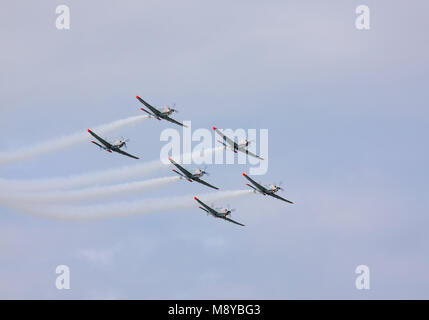 The Polish Air Force Orlik Aerobatics Team flying over sky during International Air Show at the 90th Jubilee of - Stock Photo