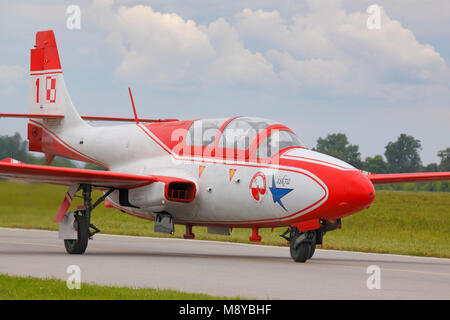 The Polish Air Force TS-11 Iskra MR of White-Red Sparks (Bialo-Czerwone Iskry) aerobatics team on runway during - Stock Photo