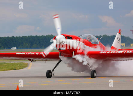 The Zlin Z-50LS of the Zelazny Aerobatic Team on runway during International Air Show at the 90th Jubilee of The - Stock Photo