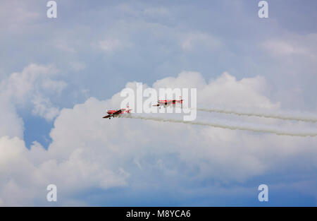 Pair of a Zlin Z-50LS of the Zelazny Aerobatic Team flying over sky during International Air Show at the Jubilee - Stock Photo