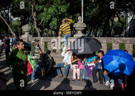 Bystanders watch a march through Mexico City protesting for the return of 43 missing Normalista students who were - Stock Photo