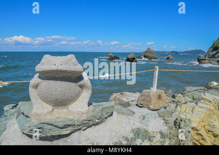 Frog Statue In Front Of Meoto Iwa (Wedded Rocks) At Ise Japan - Stock Photo