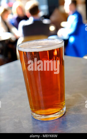 half pint of beer on pub table, norwich, norfolk, england - Stock Photo