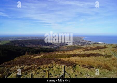 Ramsey and the Northern Plain seen from Guthries Memorial on the iconic TT Course Isle of Man - Stock Photo