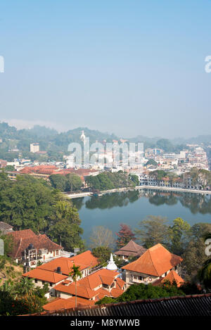 An aerial cityscape view of Kandy in Sri Lanka with Kandy Lake center on a sunny day with blue sky. - Stock Photo