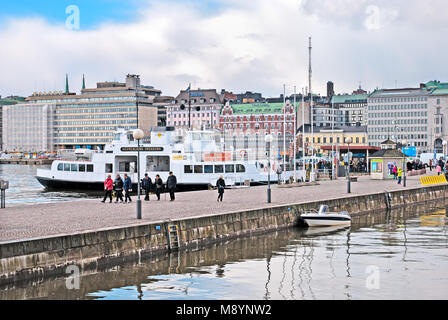 HELSINKI, FINLAND - APRIL 23, 2016: People walk on the quay near The Market Square and pier with ferry to Suomenlinna - Stock Photo