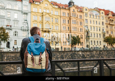 A tourist with a backpack in front of a beautiful old architecture in Prague in the Czech Republic. Travel, tourism - Stock Photo