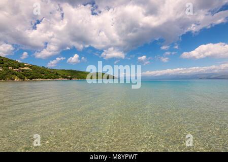 Crystal sea water, summer scenic view of Apras bay near Kassiopi on Corfu island in Greece. - Stock Photo
