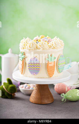 Carrot cake with frosting for Easter - Stock Photo