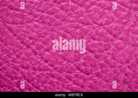 Genuine leather texture, bright pink, crimson color, matte surface, trendy background. Modern backdrop pattern banner - Stock Photo