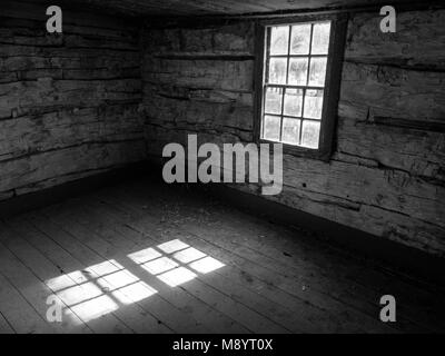 Old Log Cabin Interior, Black and White, Sunlight Through Window - Stock Photo