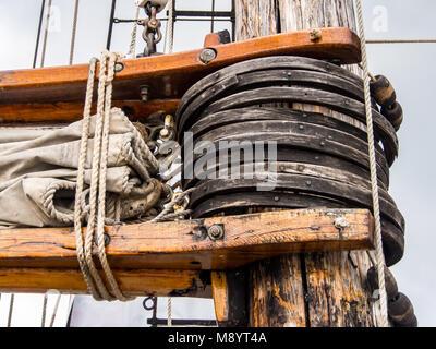 Old Ship Sail Rigging, Mast and Sail, Wooden Struts - Stock Photo