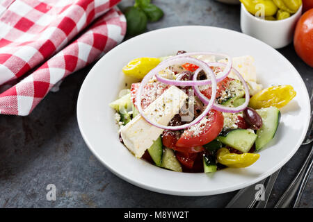 Greek salad with fresh vegetables and feta - Stock Photo