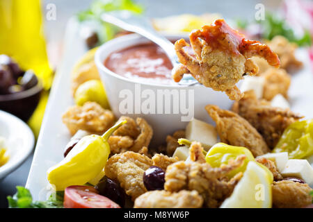 Fried calamari with marinara sauce - Stock Photo