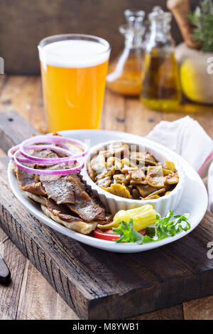 Gyro plate with meat on a pita - Stock Photo