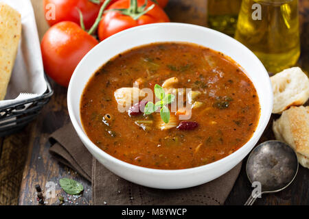 Tomato soup with beans and pasta - Stock Photo