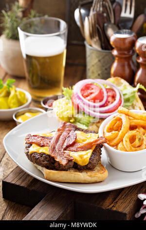 Traditional american burger with cheese and bacon - Stock Photo