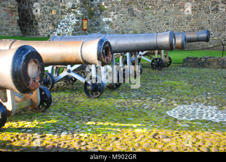 Cannons in Carrickfergus Castle, Carrickfergus, County Antrim, Northern Ireland, UK - Stock Photo