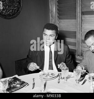 Cassius Clay (Pictured) having lunch in London before his trip to Scotland for an exhibition bout against fellow - Stock Photo