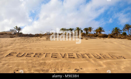 the word Fuerteventura written with pebbles on the sand of a beach in Fuerteventura, Canary Islands, Spain - Stock Photo