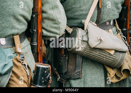 Outfit German soldier World War II. Rifle, bayonet knife and box for a gas mask - Stock Photo