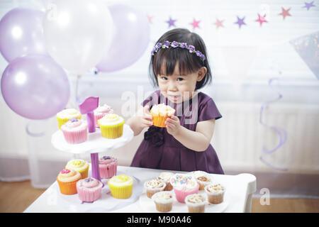 Baby girl celebrate her second birthday - Stock Photo