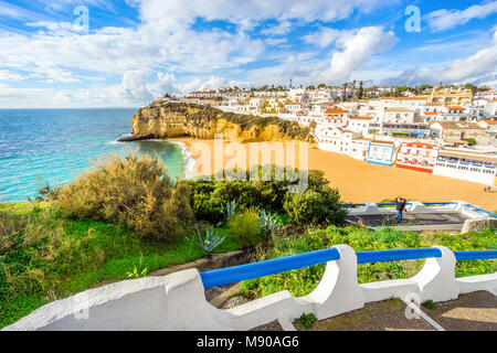 Beautiful beach, cliffs and stairs in colourful Carvoeiro, Algarve, Portugal - Stock Photo