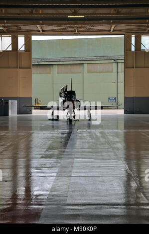 Royal Air Force Red Arrows BAe Hawk T1 jet plane cockpit at RAF Scampton in a hangar. Single aircraft. Lone aeroplane. Space for copy - Stock Photo