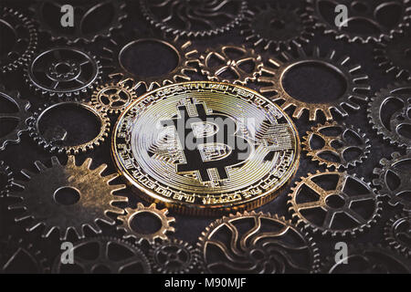 Golden bitcoin glowing in the middle of cog wheels Illustration. Digital currency of the new age concept - Stock Photo