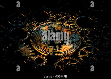 Golden fiery bitcoin glowing in the middle of intricate cog wheels digital Illustration. Crypto currency concept - Stock Photo