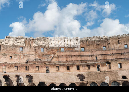 Horizontal picture of the top of the amazing architecture  of Coliseum, located in Rome, Italy - Stock Photo