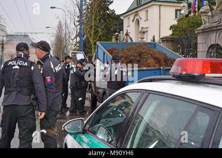 Bratislava, Slovakia. 16 March 2018. Police inspects the driver of the car that brought the cargo of manure in front of the Government Office - Stock Photo