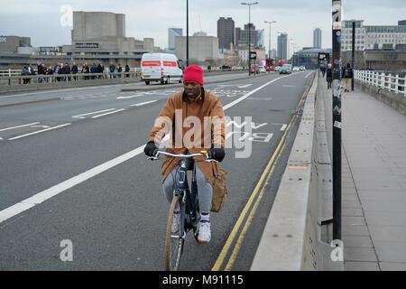 Man cycling over Waterloo bridge, London. - Stock Photo