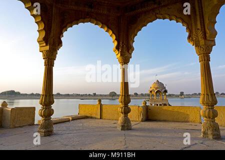 View of Gadi Sagar temple at Gadisar lake in Jaisalmer, Rajasthan, India. - Stock Photo