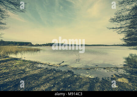 Tranquil lake landscape, image toned, vintage photo - Stock Photo