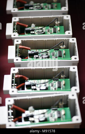 Row of electric transformers with printed circuits in close up - Stock Photo