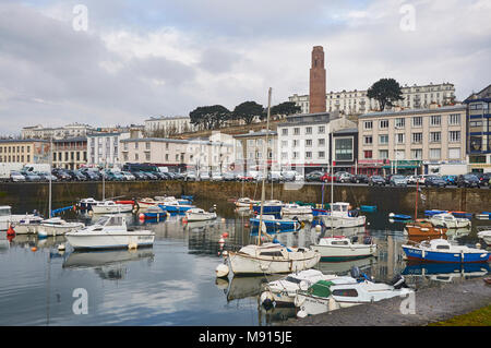 The World War 1 Naval Monument looks down over the small Harbour where the Locals keep their Pleasure Boats moored in Brest, Finistere, France. - Stock Photo
