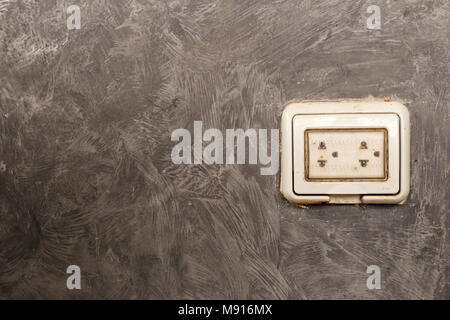 The condition of electrical outlets on the outside of the building and is protected by a plastic cover. - Stock Photo