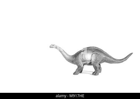 Sauropod walking on the white background.Simulation walking of the dinosaur. - Stock Photo