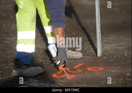 Man painting on the street, Construction - Stock Photo