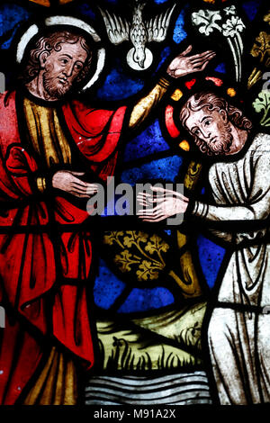 Saint-Pierre-le-Jeune Protestant Church.   The baptism of Jesus by John the Baptist.  Stained glass window.  Strasbourg. France. - Stock Photo