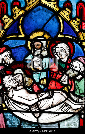 Temple Saint-ƒtienne Calvinist church. Stained glass window. The burial of Christ. Strasbourg. France. - Stock Photo