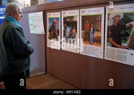 Oikocredit is a worldwide cooperative that promotes sustainable development by providing loans. Pictures exhibition.  Strasbourg. France. - Stock Photo