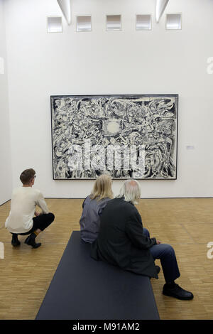 Musee National d'Art Moderne (National Modern art Museum), Georges Pompidou centre, Paris, France. Visitors looking at a painting by Pierre Alechinsky - Stock Photo