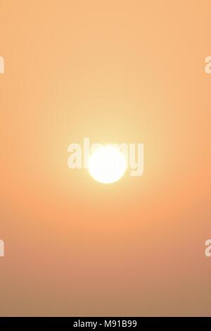 Nature background shining morning Sun with solar flares - Stock Photo