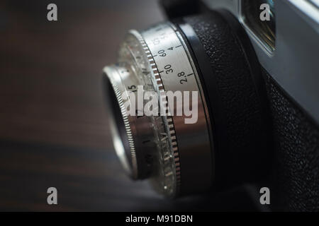 An old camera lens close-up. Shallow DOF. - Stock Photo
