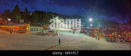 Night skiing panorama at Borovets Ski resort, near Samokov, Targovishte, Bulgaria. - Stock Photo
