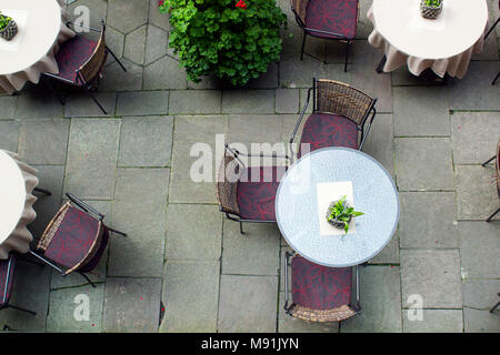 Tables and chairs on terrace, top view. Yard furniture, view above - Stock Photo