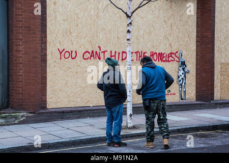 London, UK. 17th March, 2018. Two men talk outside Sofia House in Great Portland Street which was occupied by homeless support activists to set up the - Stock Photo